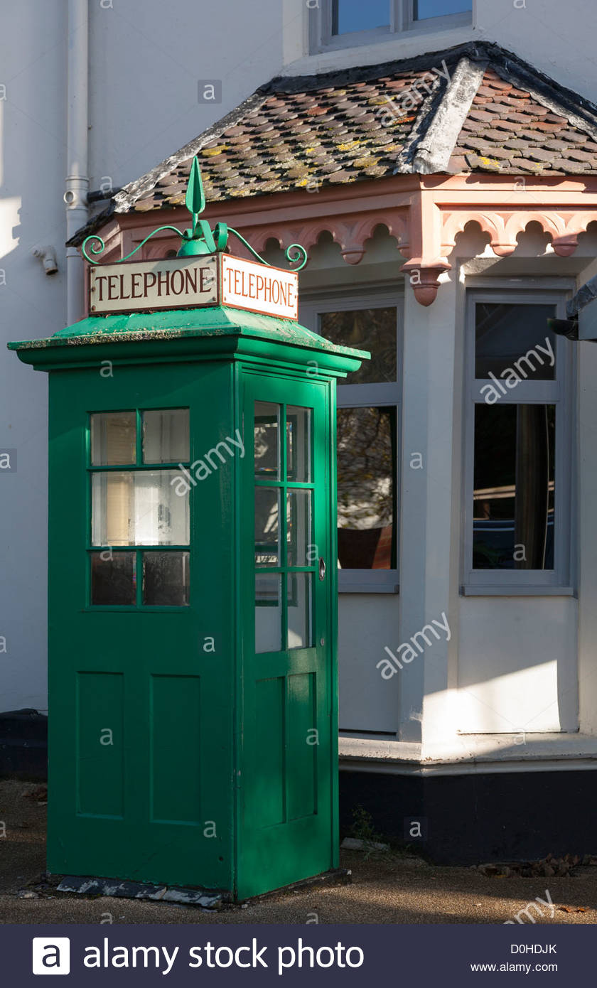 green telephone kiosk out the Boulters Inn and Restaurant in Maidenhead Berkshire on the Riverside (River Thames) - Stock Image
