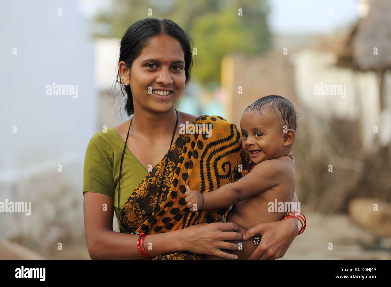 Indian mother holding her baby son Andhra Pradesh South India Stock