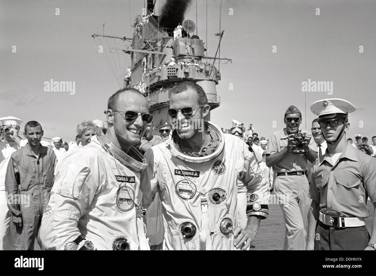 Astronauts L. Gordon Cooper Jr. (right) and Charles Conrad Jr. walk across the deck of the recovery aircraft carrier Stock Photo