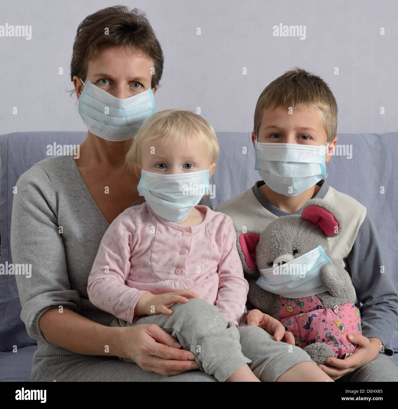 Family in protective masks - Stock Image
