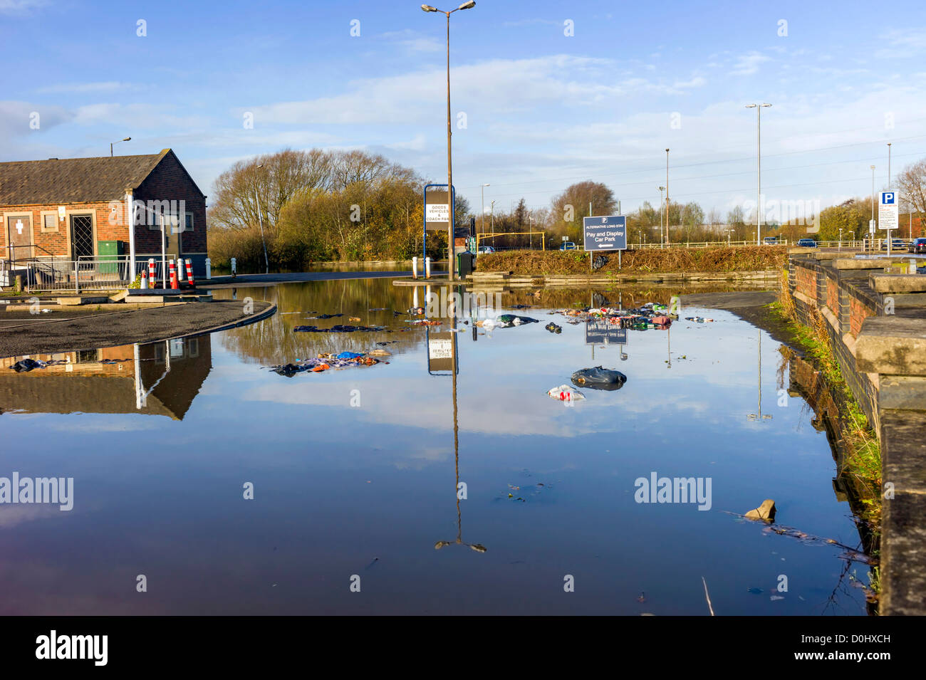 After days of rainfall the car park is closed, scenes of flooding, floating debris, abandoned cars await their owners - Stock Image