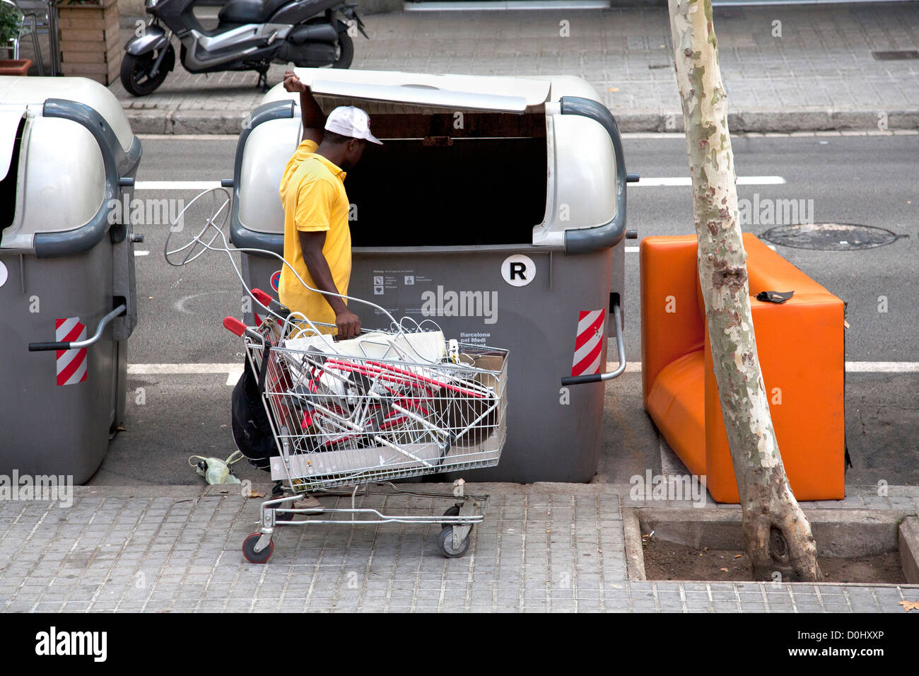 Man going through the rubbish looking for scrap metal - Stock Image