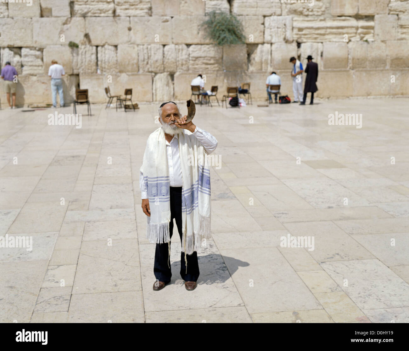 Orthodox jewish male, Shlomo Tovy blowing the shofar by the Wailing Wall, Jerusalem, Israel, Middle East - Stock Image