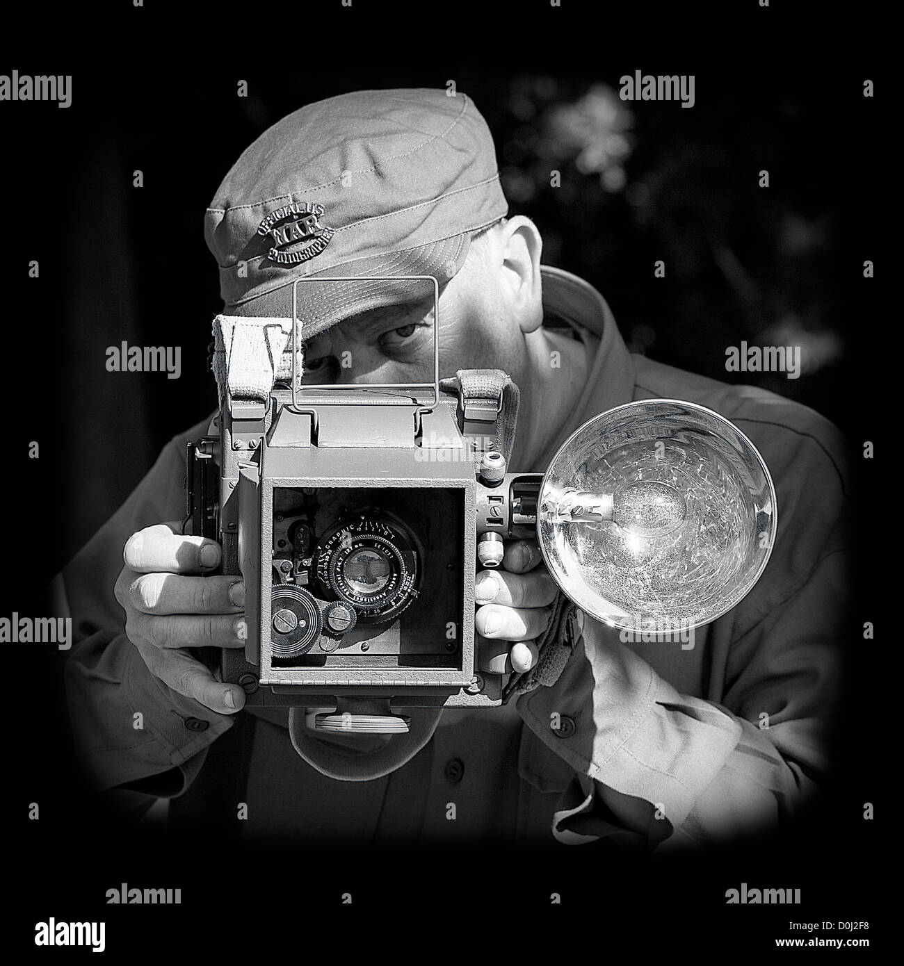 Official US War Photographer (Recreation) with US Combat Graphic 45  & with 127mm Kodak Anastigmat lens Stock Photo