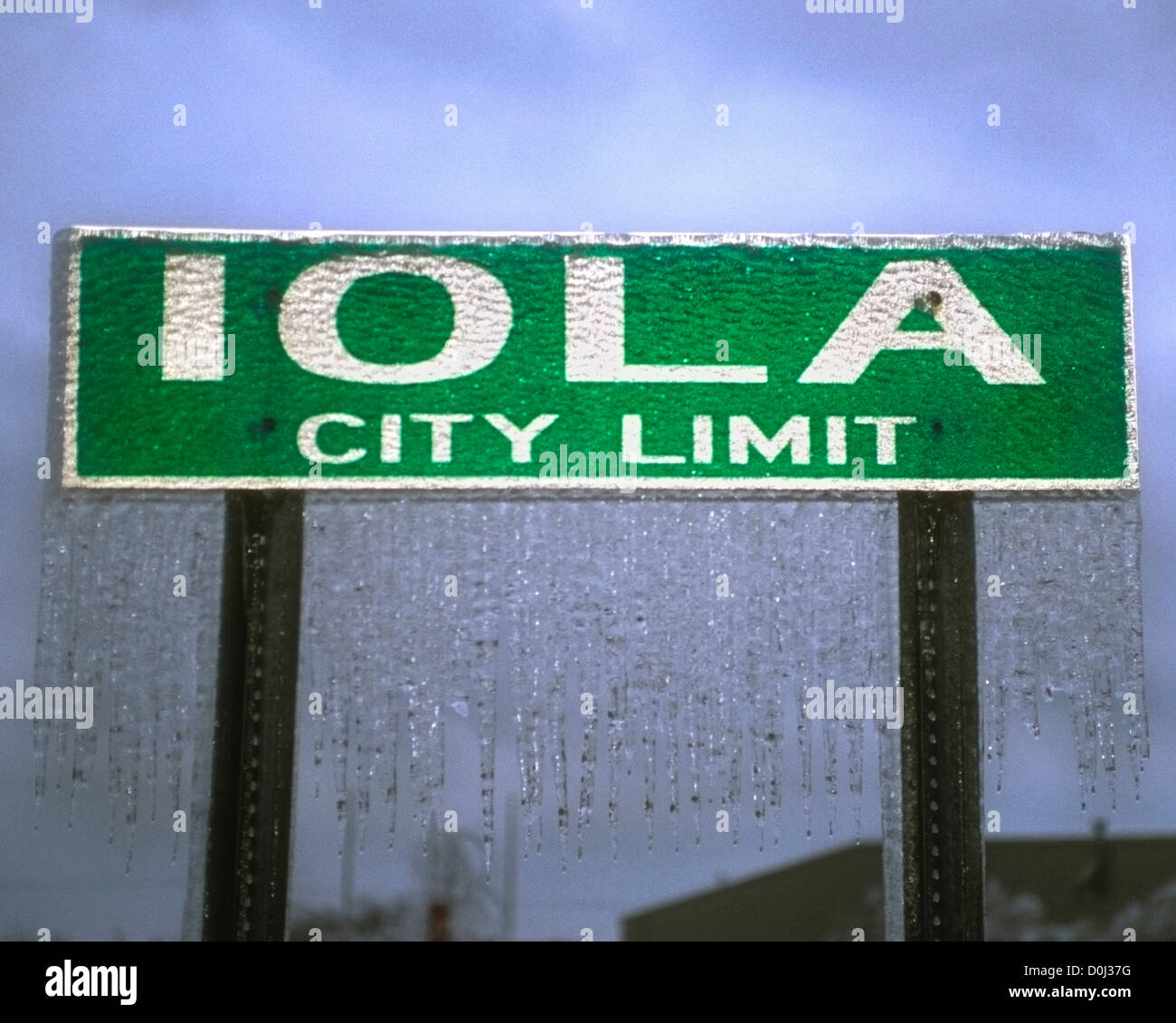 Icicles Dangle From City Sign - Stock Image