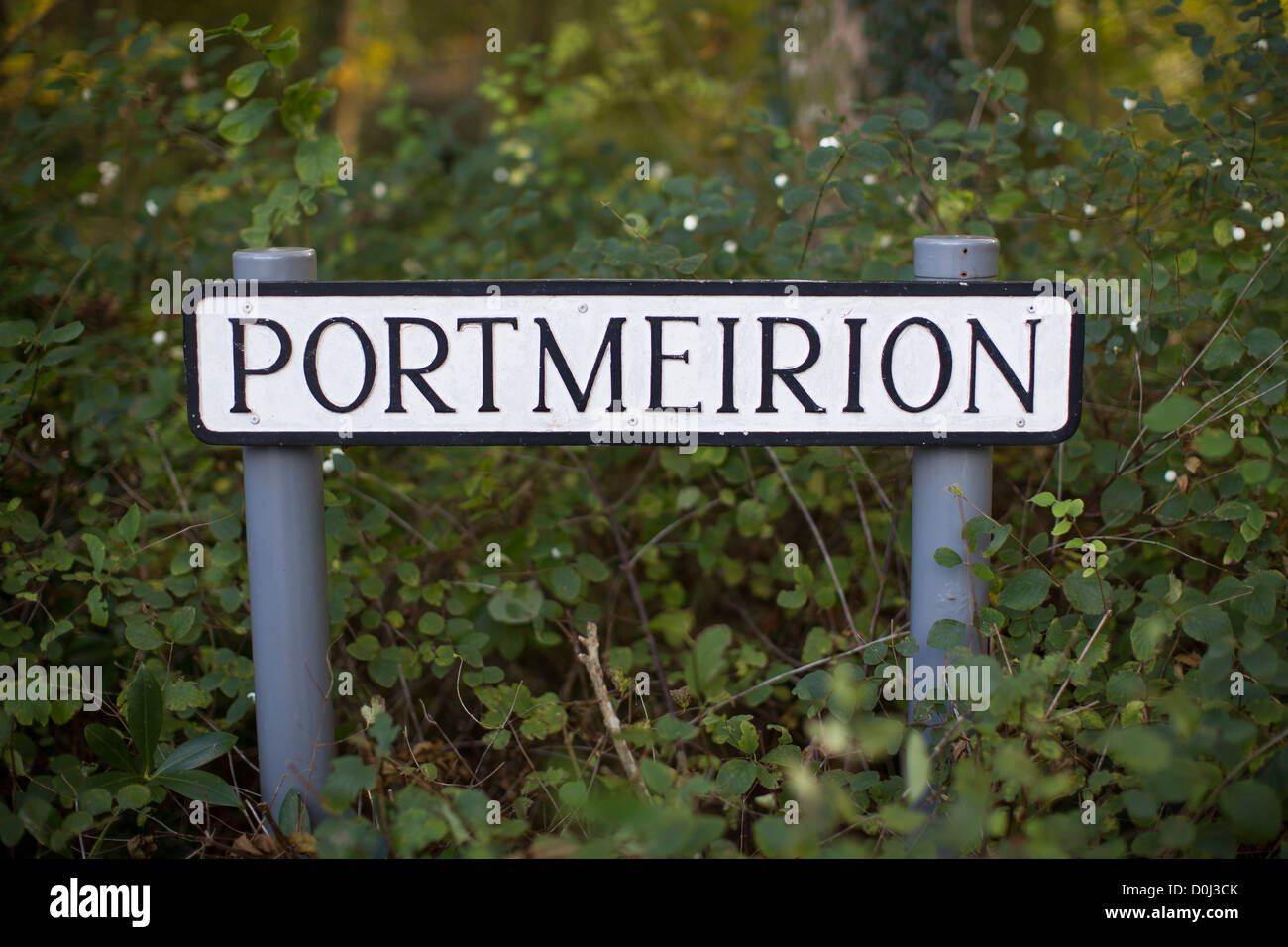 General view of Portmeirion road sign. The village was designed and built by Sir Clough Williams-Ellis in North - Stock Image