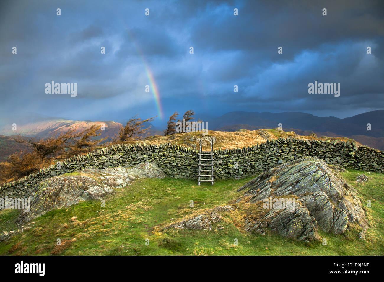 Rainbow over Black Crag near Windermere. - Stock Image