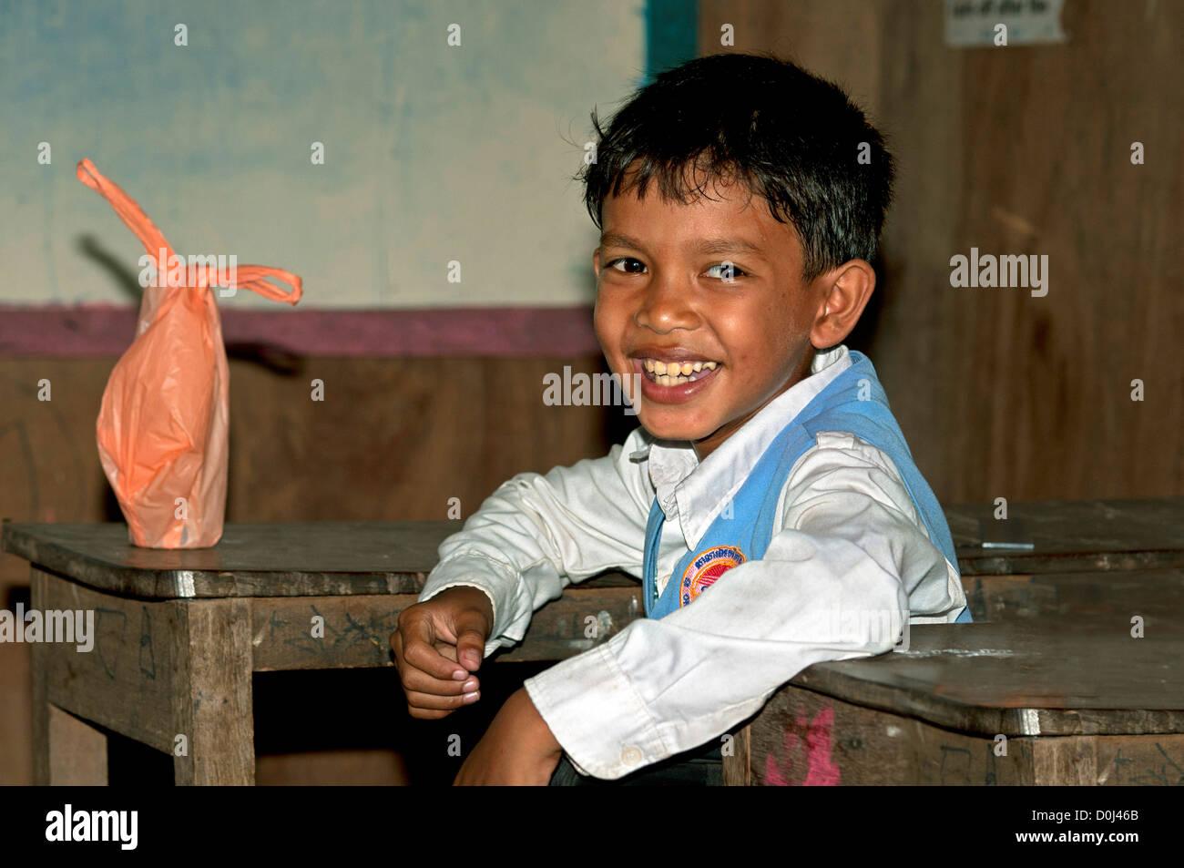 Primary school pupil dressed in school uniform at a school of Areyskat village near Phnom Penh, Cambodia - Stock Image