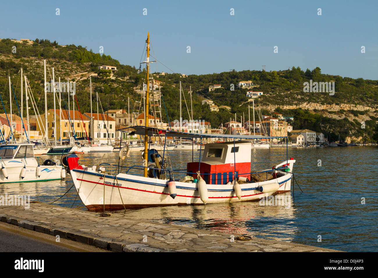 Fishing boat moored at Gaios harbour Paxos, Greece - Stock Image