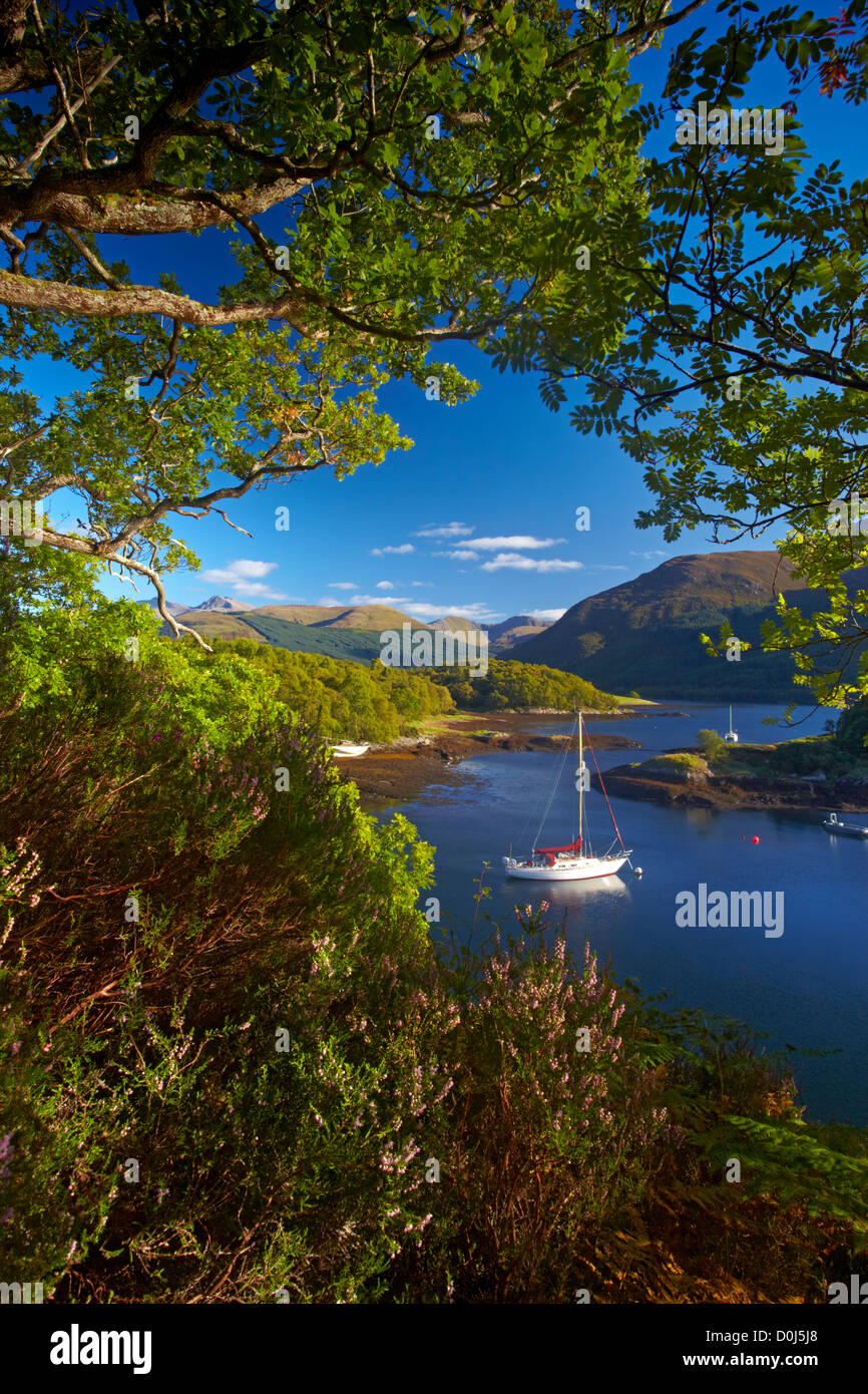 A yacht anchored in the calm waters of Loch Leven at Bishop's Bay. Stock Photo