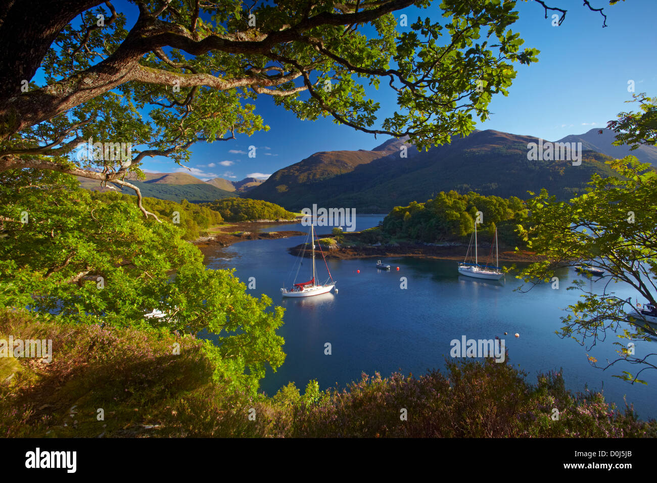Yachts anchored in the calm waters of Loch Leven at Bishop's Bay. - Stock Image