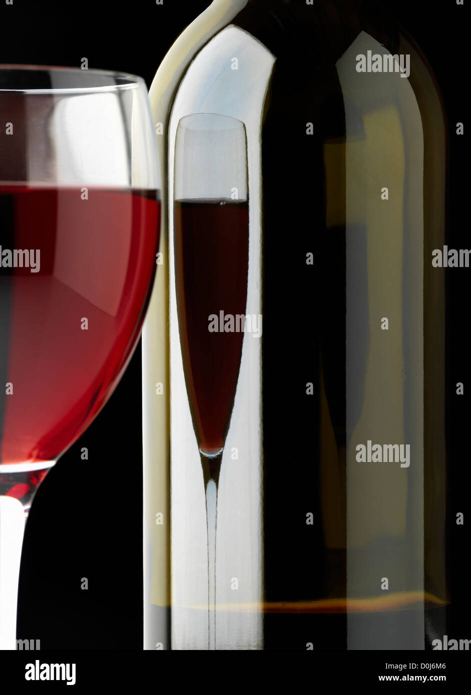 glass of red wine and wine bottle - Stock Image