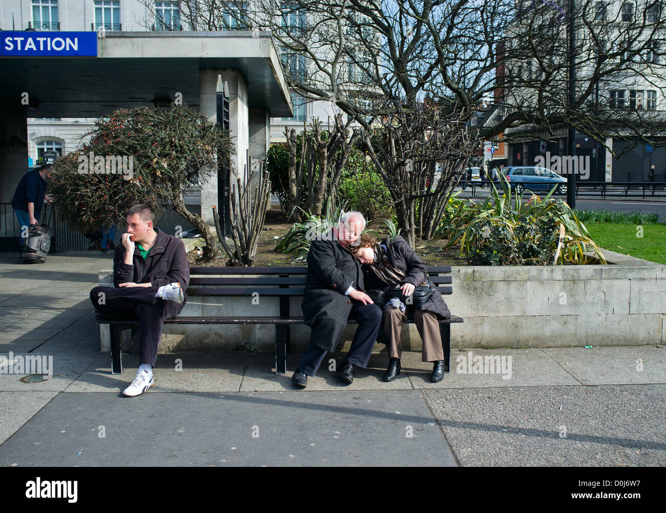 A couple sleeping on a bench in London. Stock Photo
