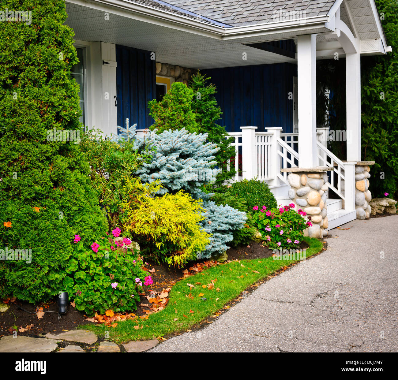 Front entrance of house with garden and porch Stock Photo
