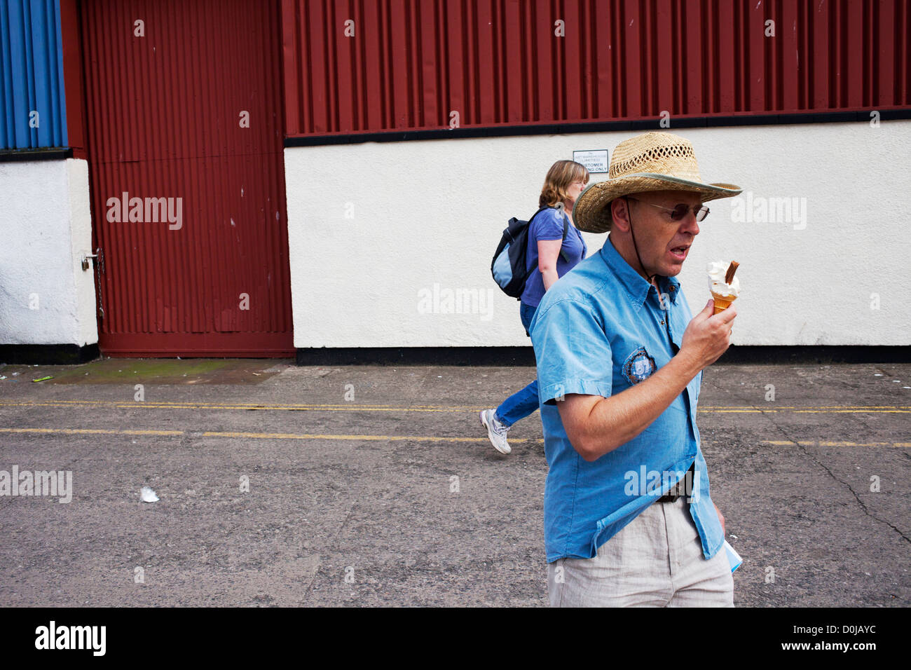 A man eating an ice cream at Harbourside in Bristol. - Stock Image