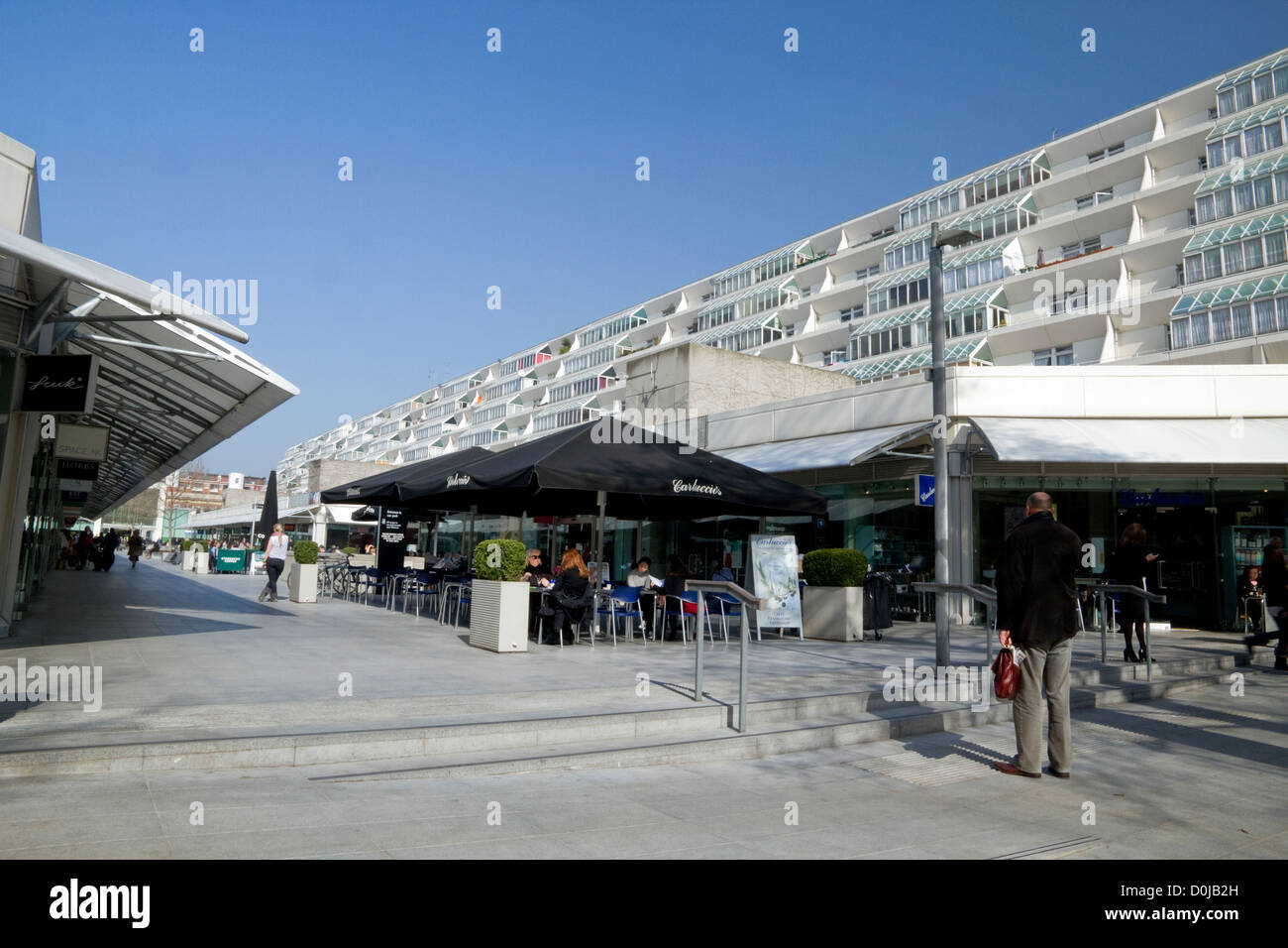 Shoppers and diners enjoying the spring weather at the Brunswick Centre. - Stock Image