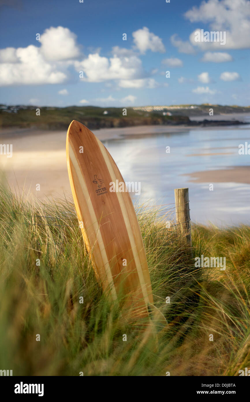 A surfboard in the dunes at Godrevy Point. - Stock Image