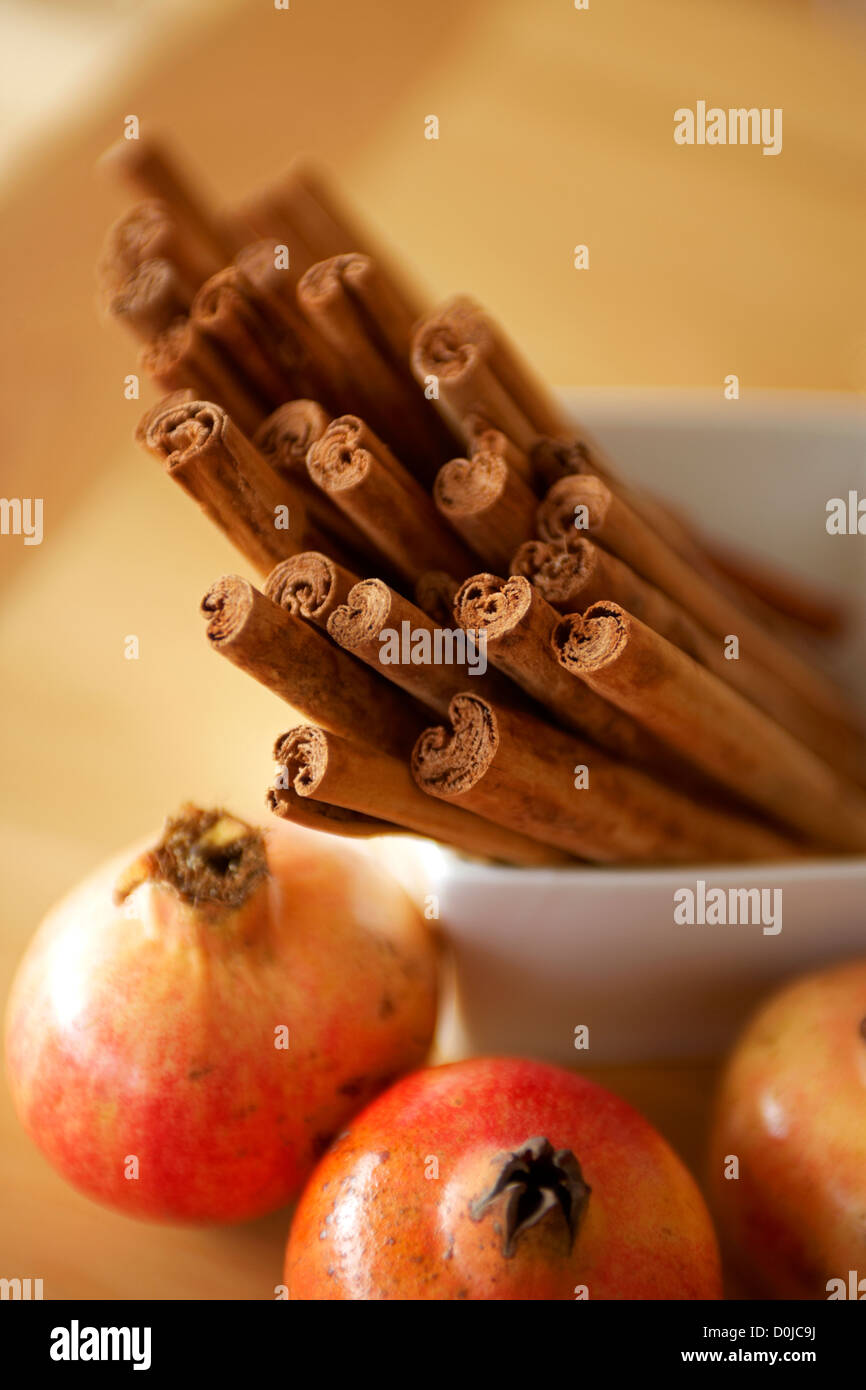 Cinnamon swirls and pomegranates. - Stock Image