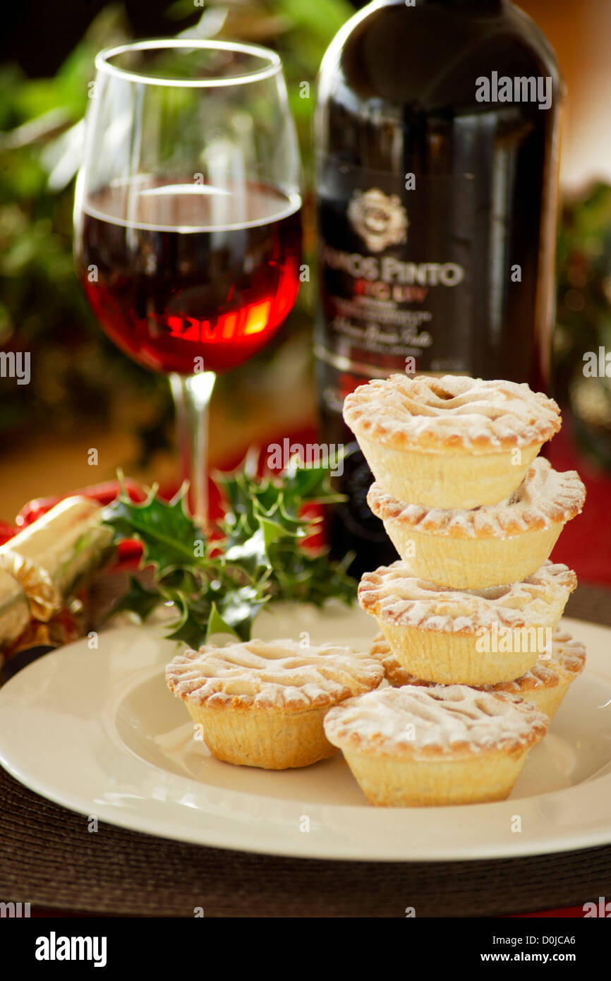 Mince pies dusted with icing sugar and ready for serving with mulled wine. Stock Photo