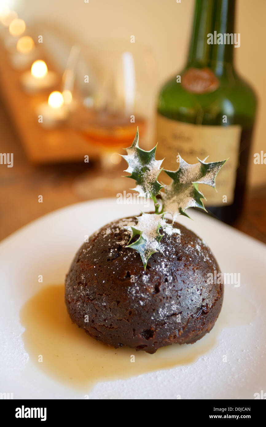 Traditional xmas pudding in brandy. - Stock Image