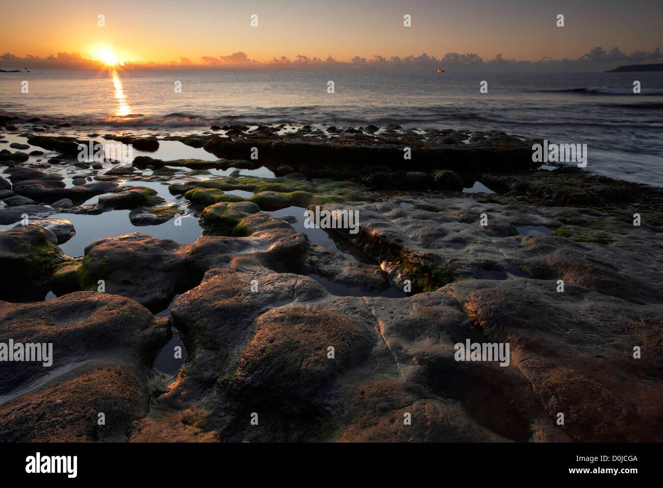 Sunrise over Osmington Mills beach on the Jurassic Dorset coast. - Stock Image