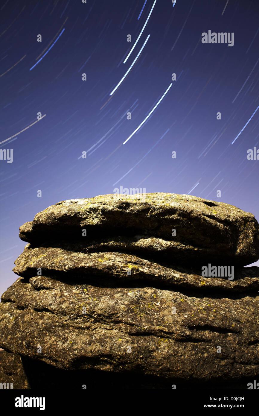 Polaris star trail over moonlit Combestone Tor on Dartmoor. Stock Photo