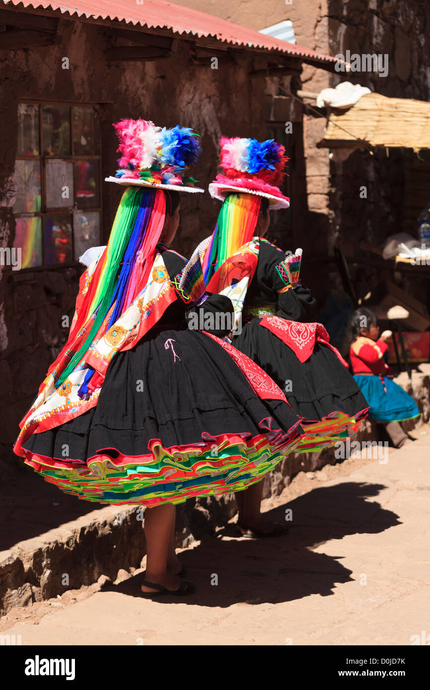 Two women in traditional costumes on Isla Taquile, Lake Titicaca, Peru - Stock Image