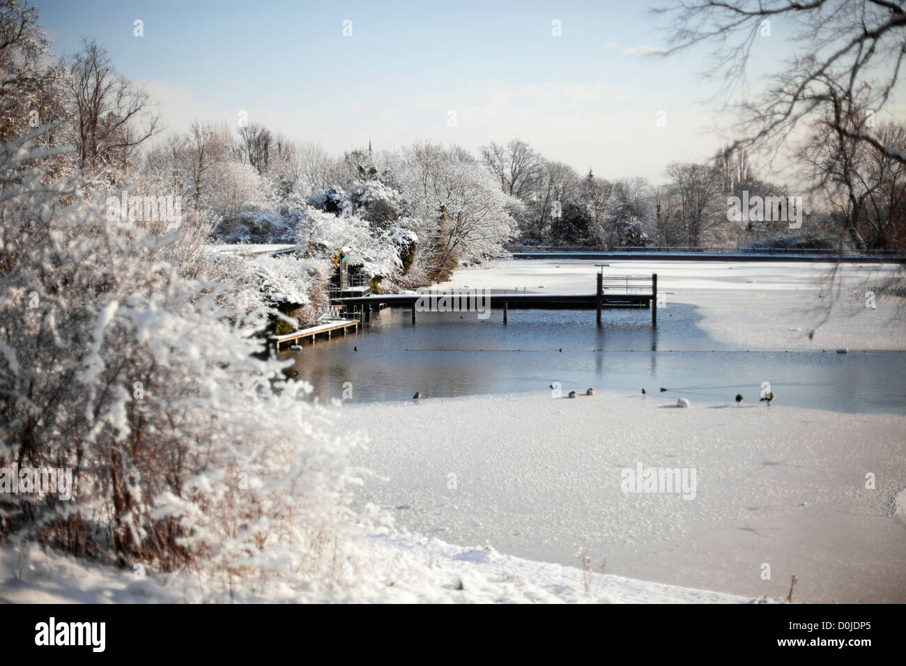 Ice and snow cover the men's bathing pond in winter. - Stock Image