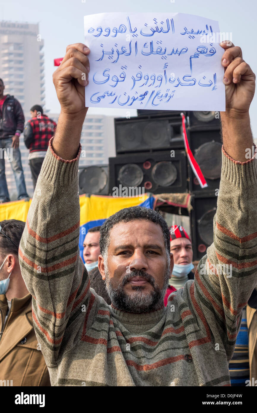 27th November 2012. A demonstrator protests against President Morsi's assumption of absolute powers at Tahrir - Stock Image