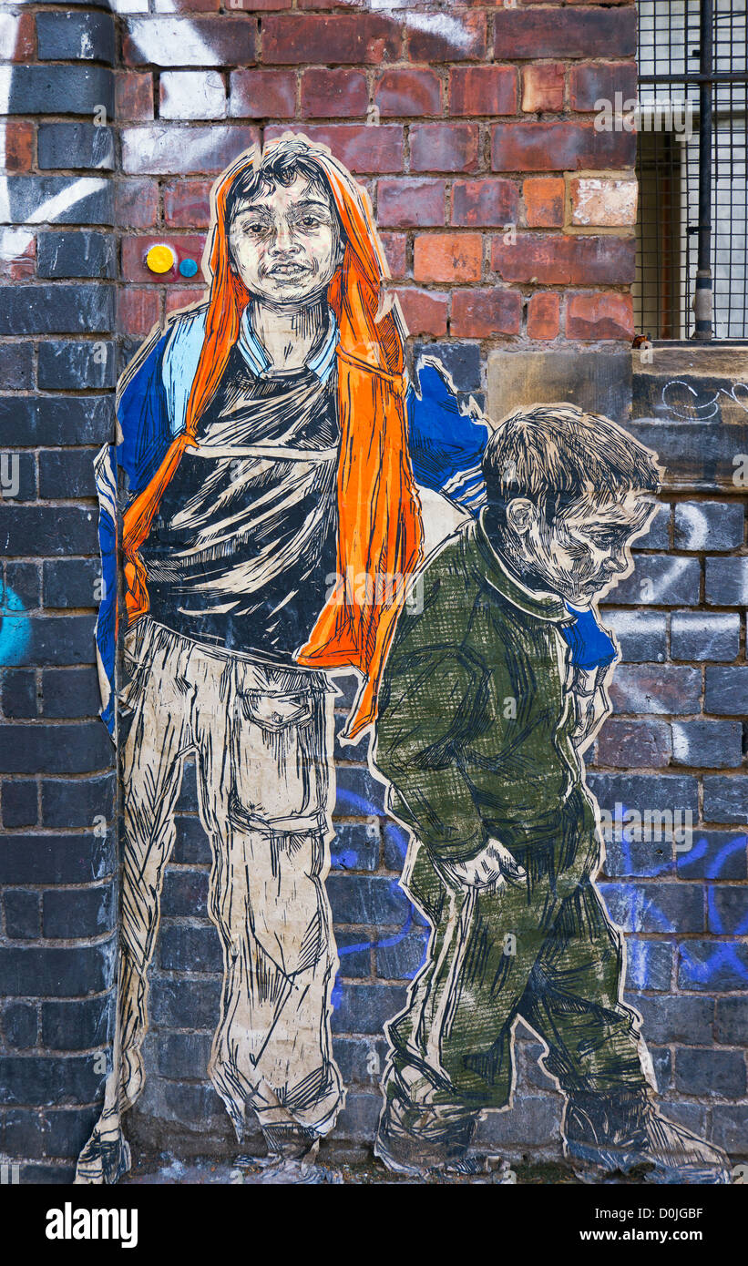 Boys drawn on paper stuck on a wall in Shoreditch. - Stock Image