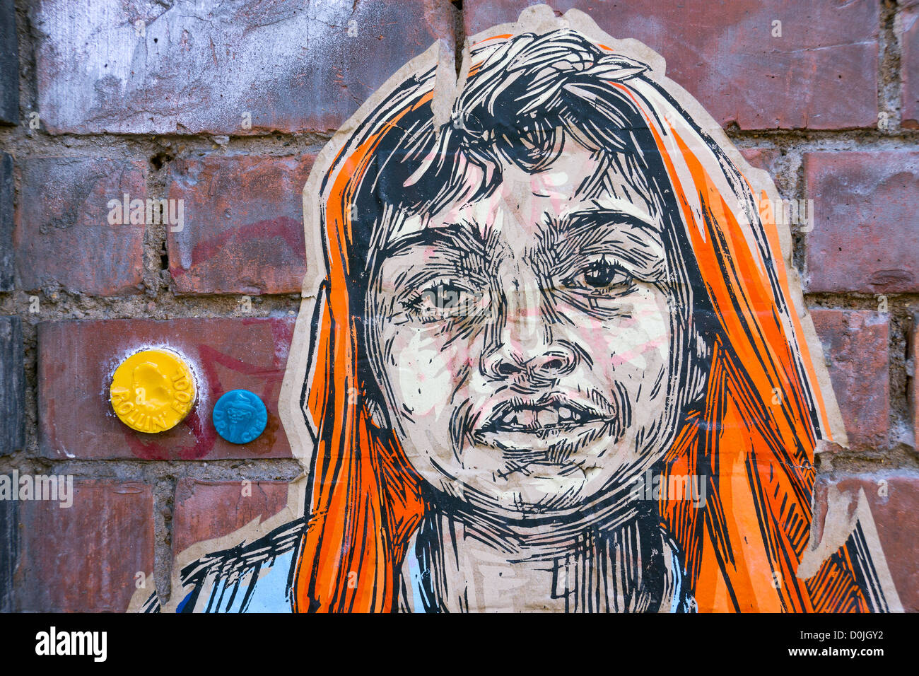 Boy's face on paper stuck on a wall in Shoreditch. - Stock Image