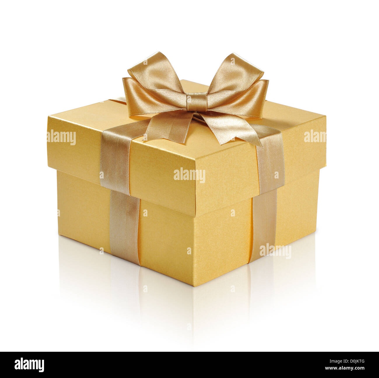 Golden gift box with golden ribbon over white background. Clipping path included. - Stock Image