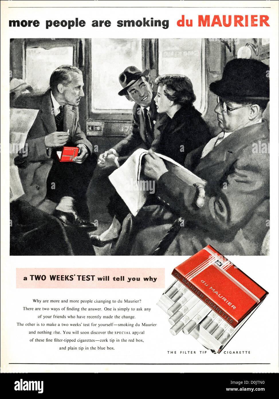 Original 1950s vintage print advertisement from English magazine advertising du Maurier cigarettes circa 1953 - Stock Image