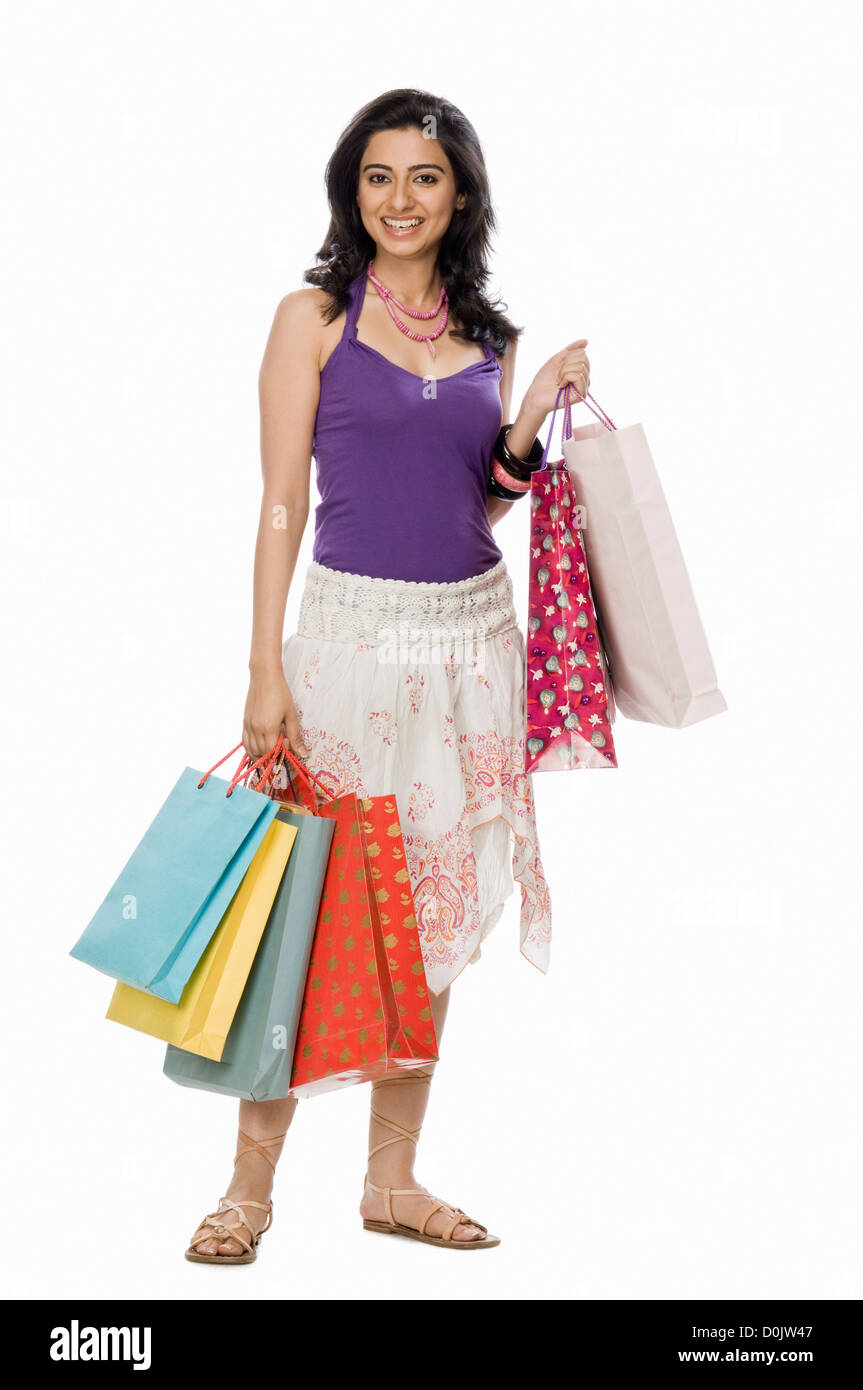 Portrait of a woman carrying shopping bags - Stock Image