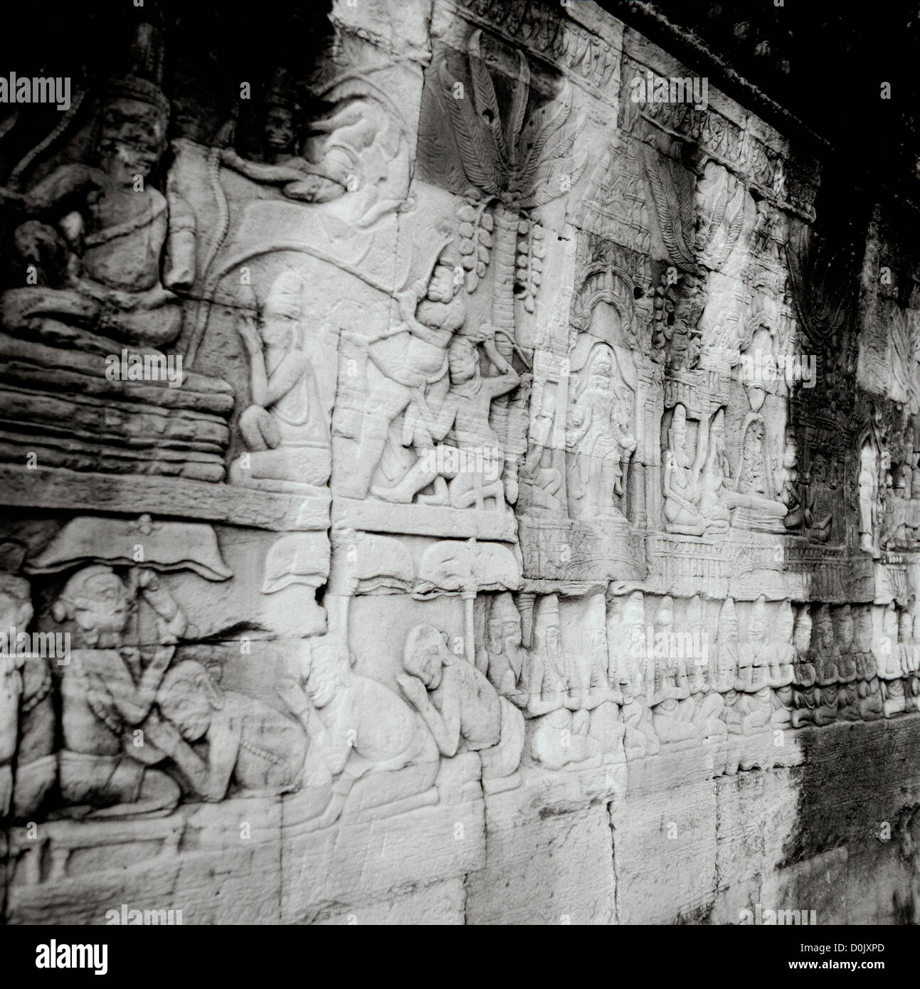 Bas relief Khmer carvings at the Bayon Temple of Angkor Thom at the Temples of Angkor in Cambodia in Southeast Asia. - Stock Image