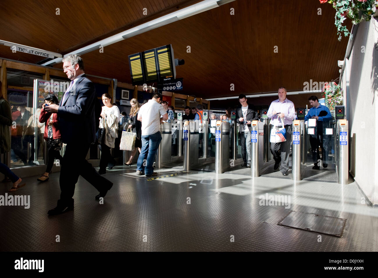 Manchester commuters arrive at Oxford Road railway station. - Stock Image