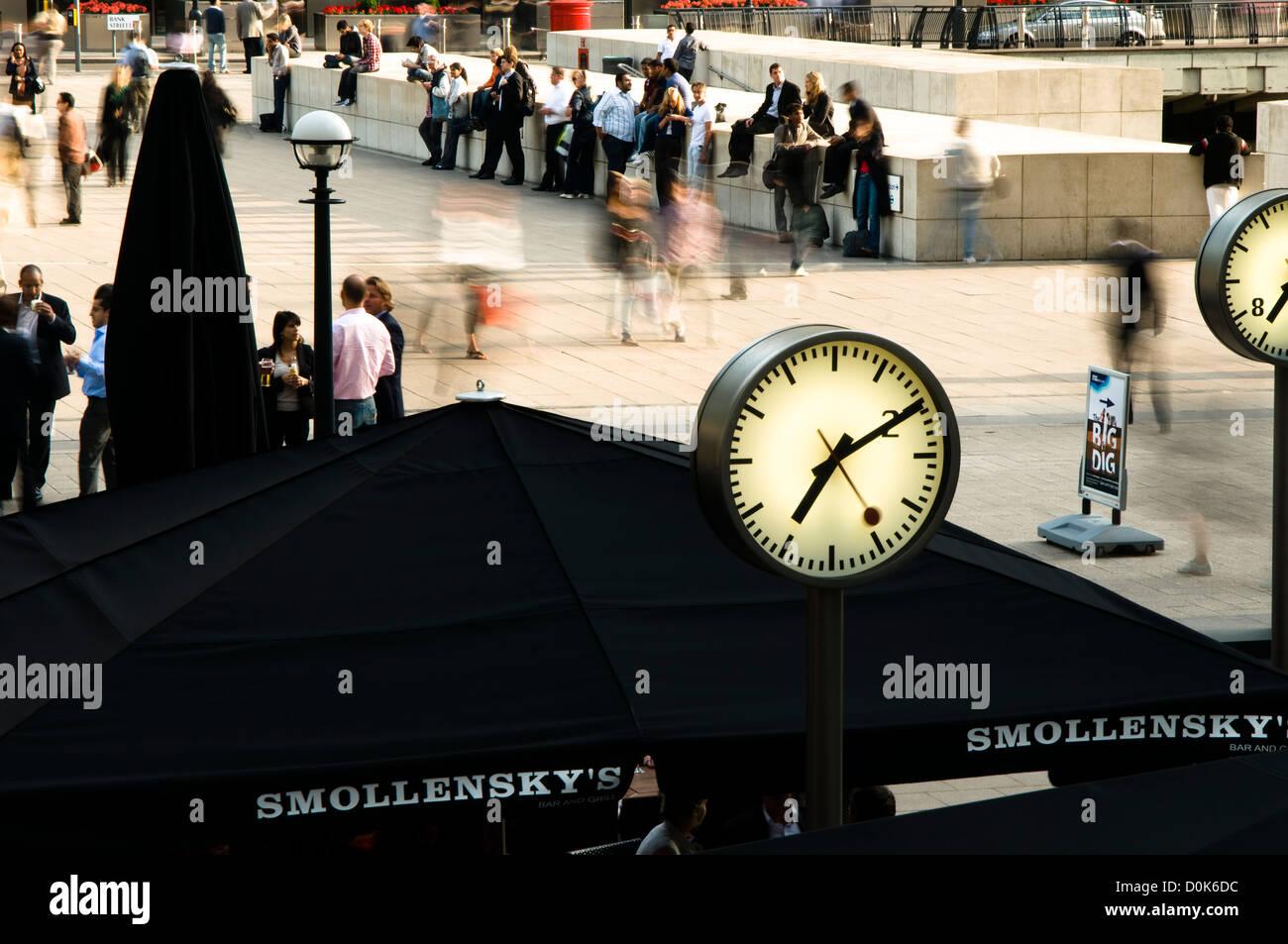 Clocks at Canary Wharf. - Stock Image