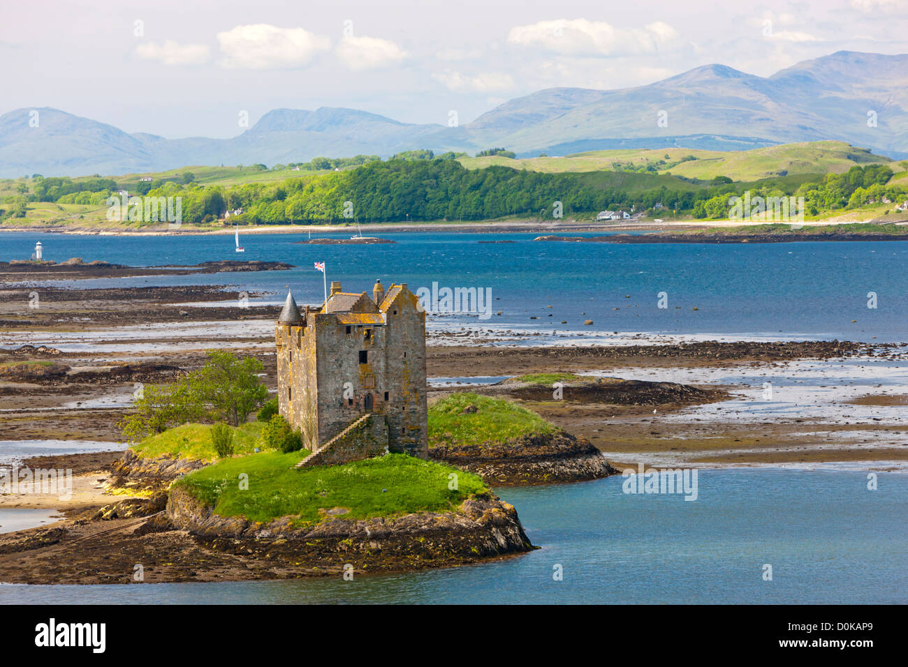 Castle Stalker which is a 15th century tower house on a tidal islet on Loch Laich. - Stock Image
