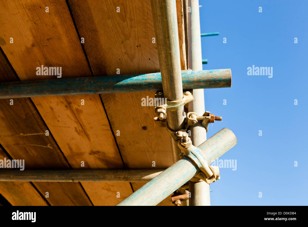 Close up underneath scaffold joints under a platform using scaffolding poles and couplers, England, UK - Stock Image