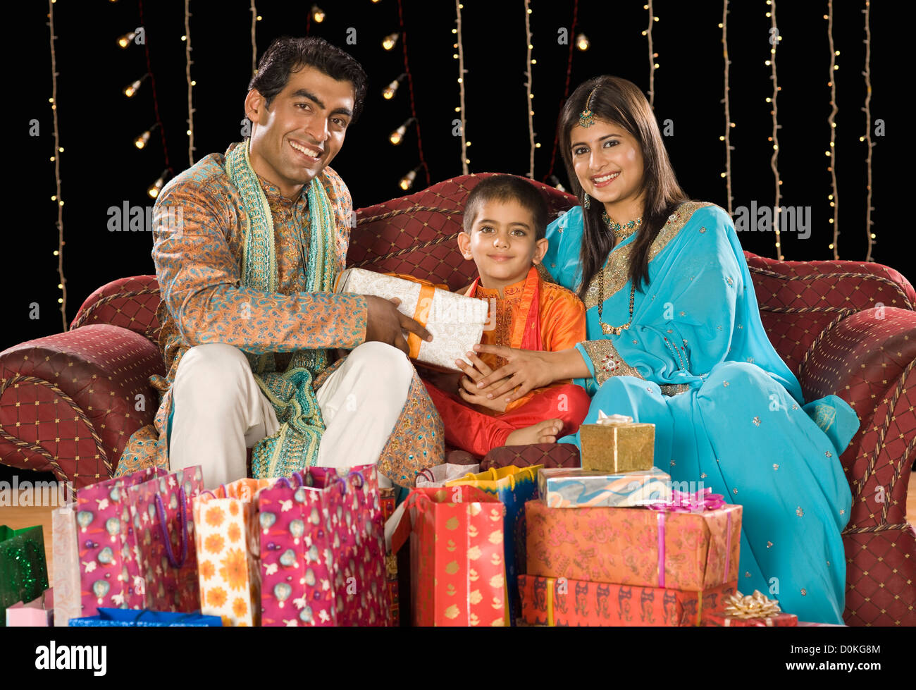 Couple giving Diwali gift to their son Stock Photo: 52060980 - Alamy for Diwali Gifts For Family  35fsj