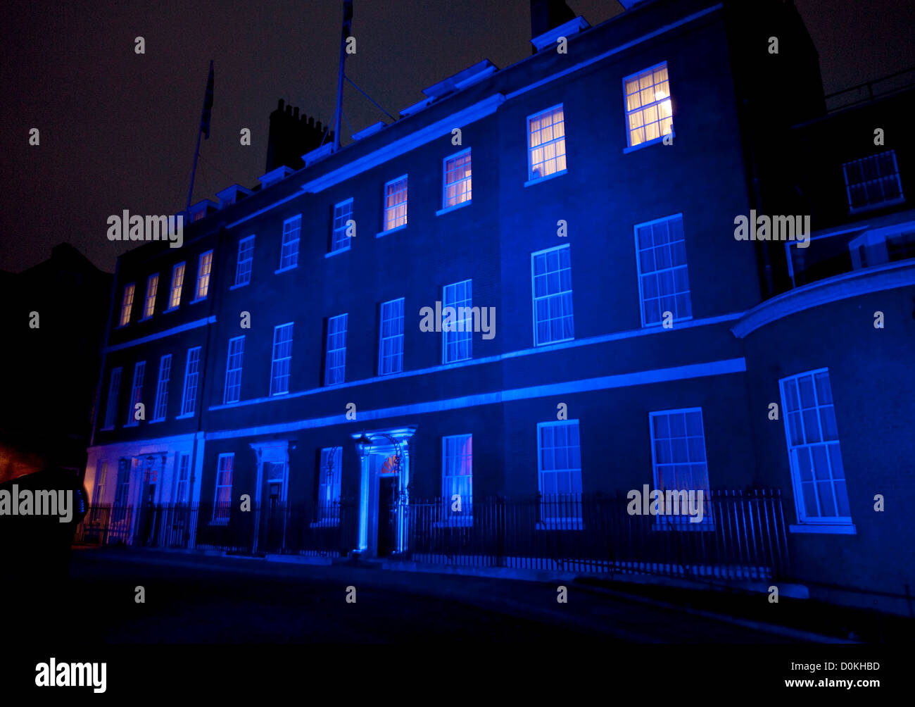 14/11/2012. London, U.K. Downing street this morning (14/11/2012), lit up in blue, for the world diabetes day. - Stock Image