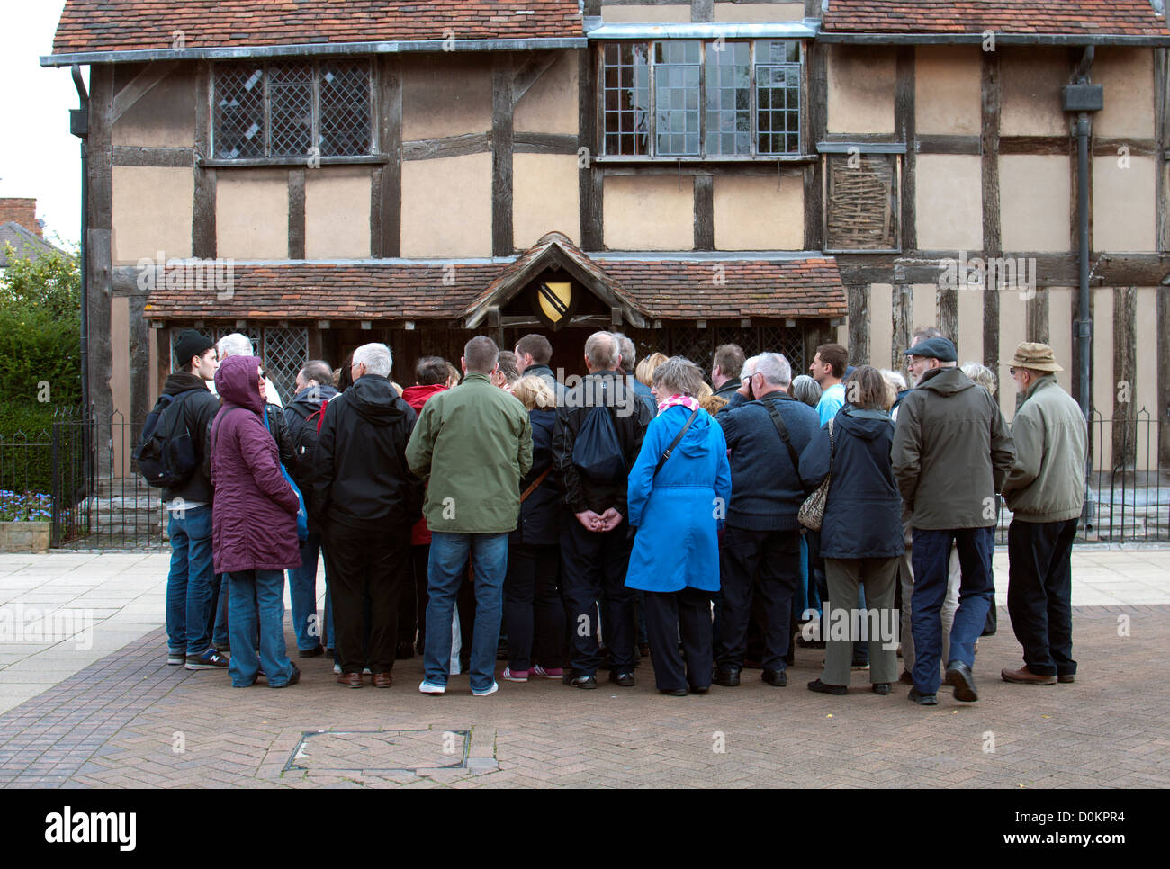 A guided tour outside William Shakespeare`s Birthplace, Stratford-upon-Avon, UK - Stock Image