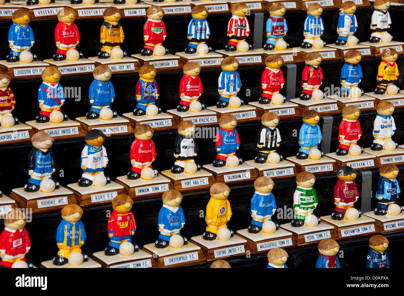 Painted models of football players in team colours - Stock Image