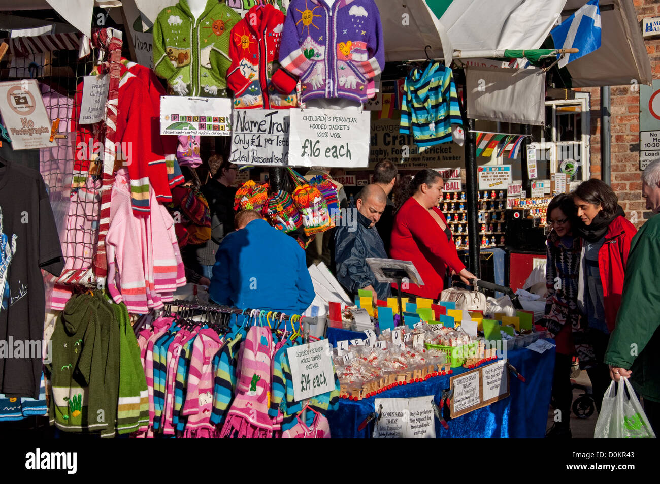 Childrens clothing for sale on market stall York North Yorkshire England UK United Kingdom GB Great Britain - Stock Image