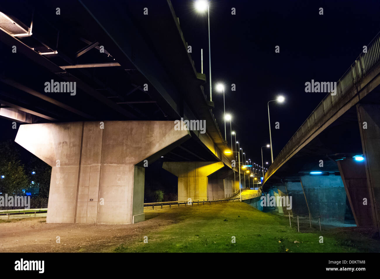Looking up at a flyover in West Thurrock leading to the Dartford Crossing. - Stock Image