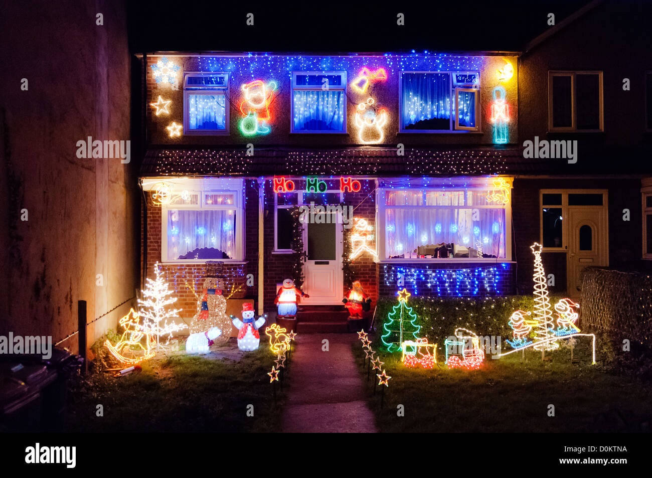 Over the top and tacky Christmas decorations on a residential house in West Thurrock in Essex. - Stock Image