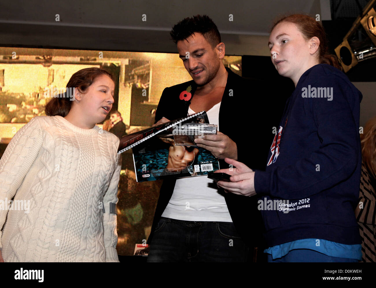 Peter Andre signs copies of his new album Angels & Demons for fans in HMV store on Oxford Street, London - Stock Image
