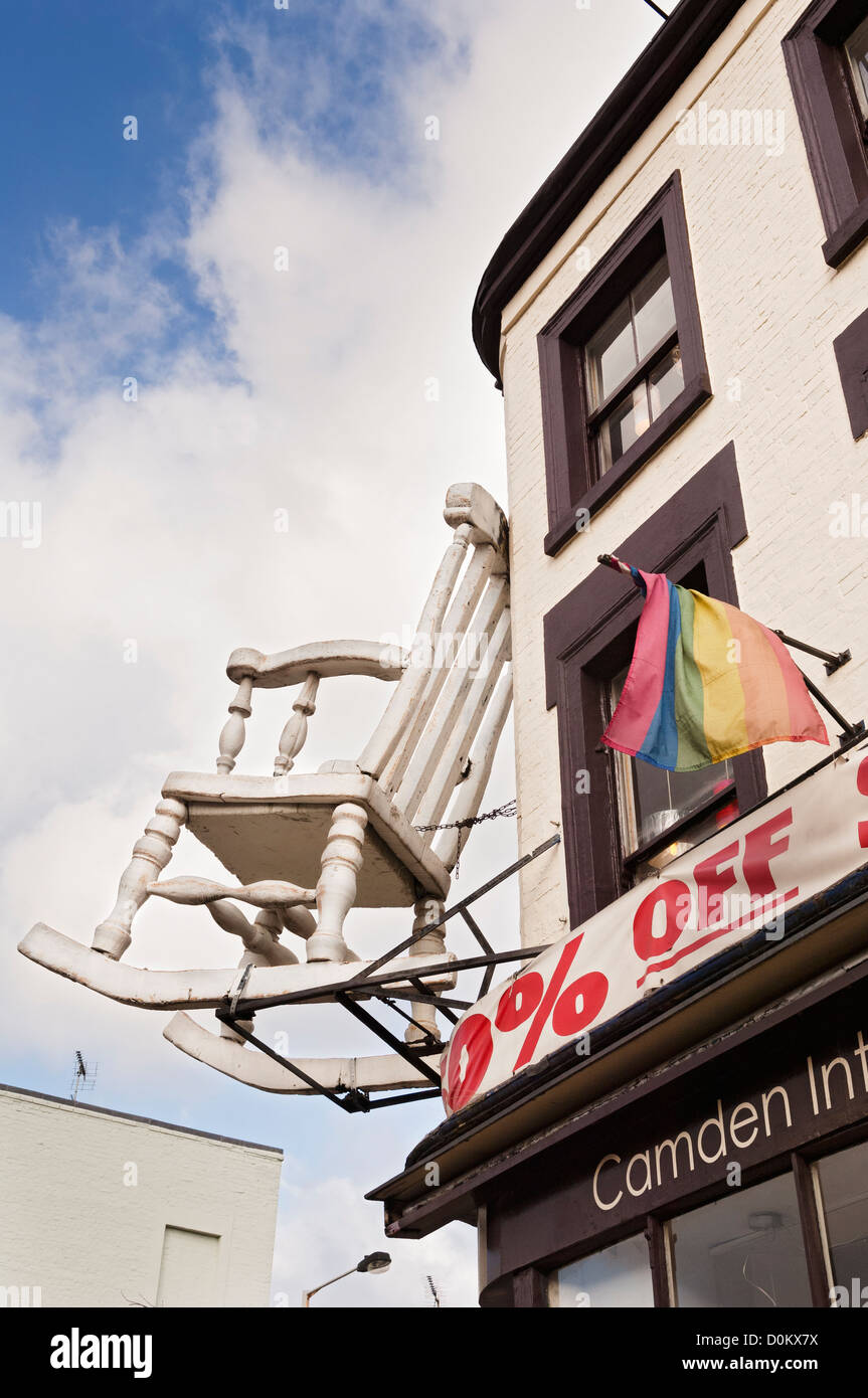 Larger than life model of a wooden rocking-chair above the entrance to a furniture shop on Chalk Farm Road in Camden. - Stock Image