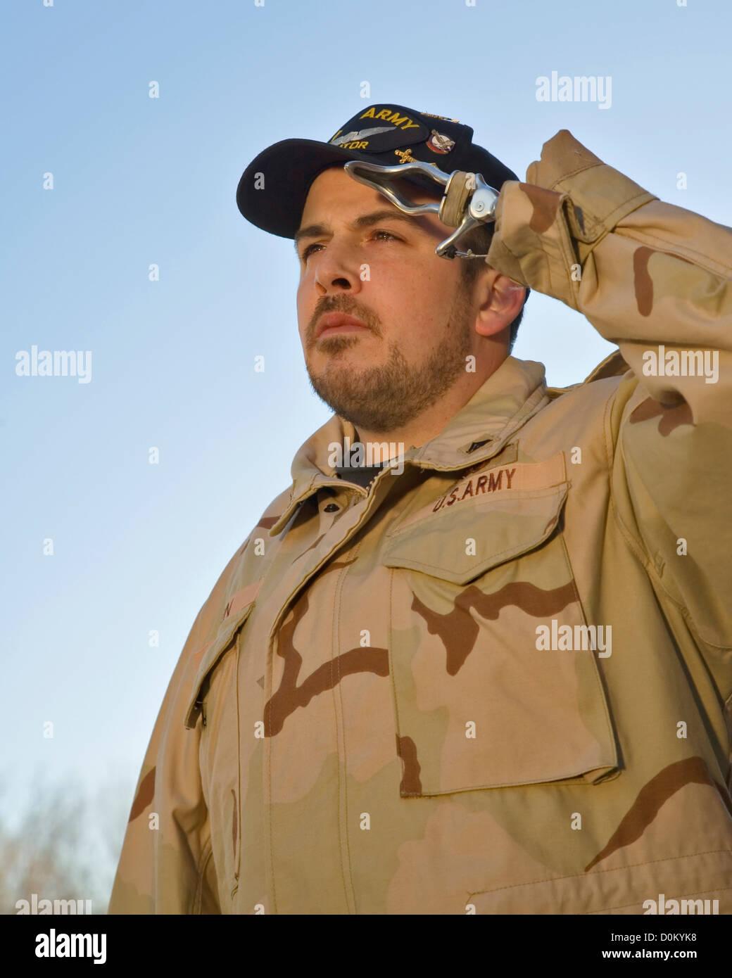 Young Veteran Saluting with Prosthetic Limb - Stock Image