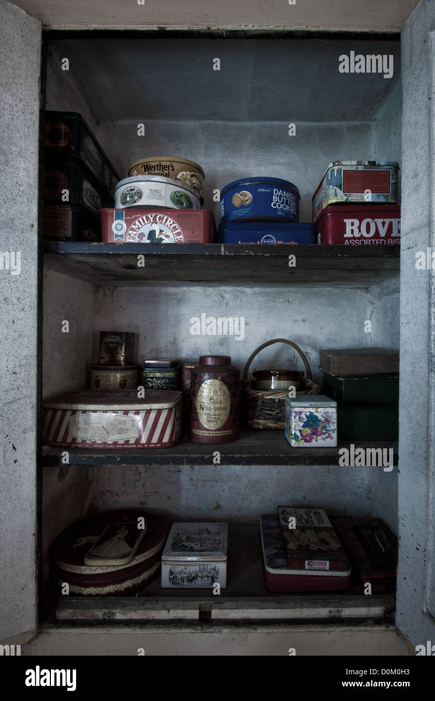 Old tins found in a cupboard - Stock Image